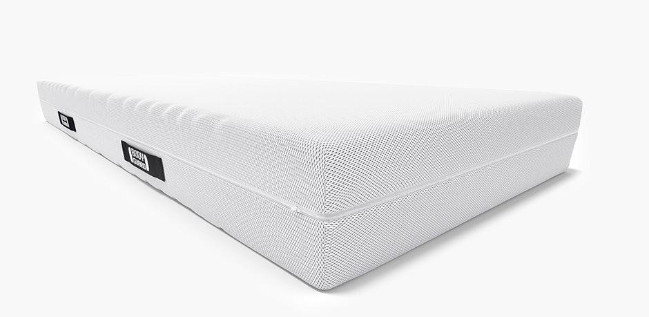 El colchón Anti-Cartel BODYGUARD. En una esquina se ve el núcleo del colchón con los diferentes grados de dureza: firmeza media y alta.
