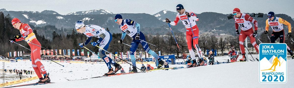 Foto: Seis esquiadores de fondo en la carrera; publicidad de bett1 en sus maillots.